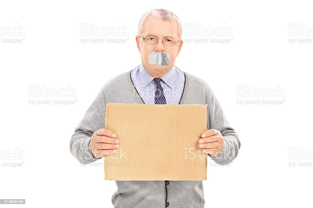 Senior with duct taped mouth holding a blank sign stock photo