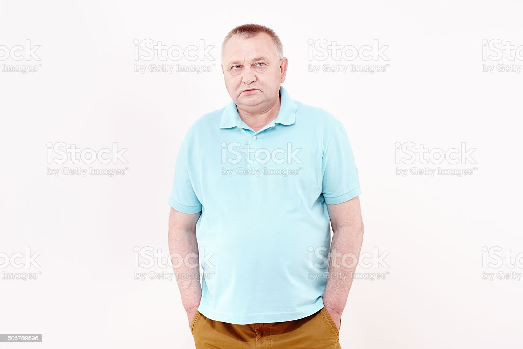 Senior with hands in pockets stock photo