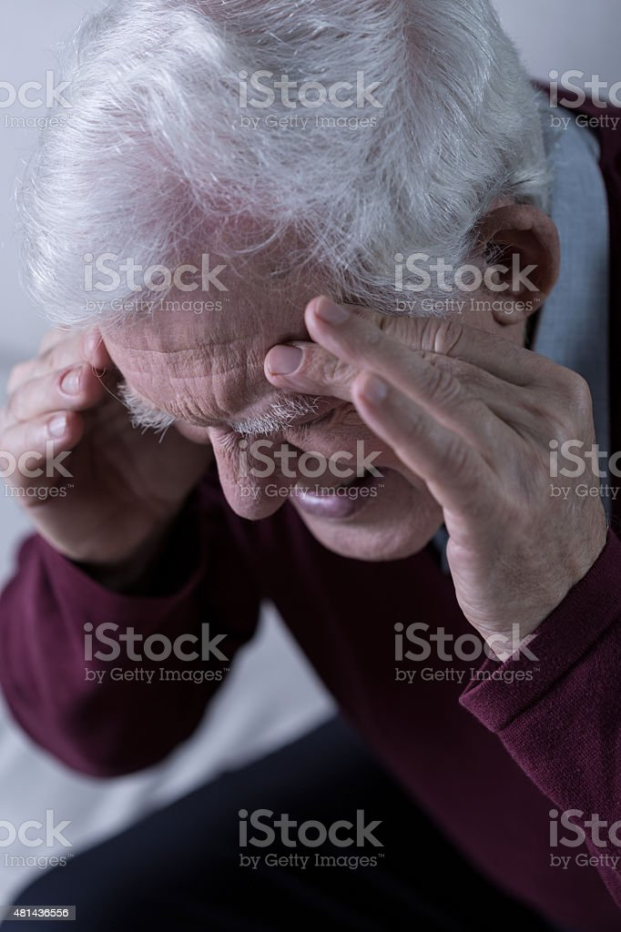 Senior with headache stock photo