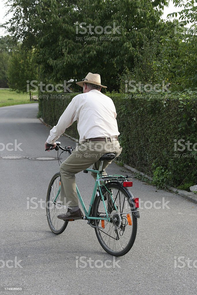 senior with his bike stock photo
