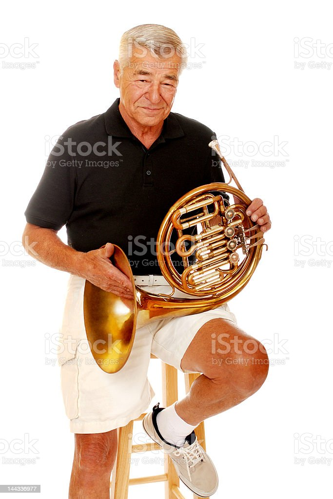 Senior with his French Horn stock photo