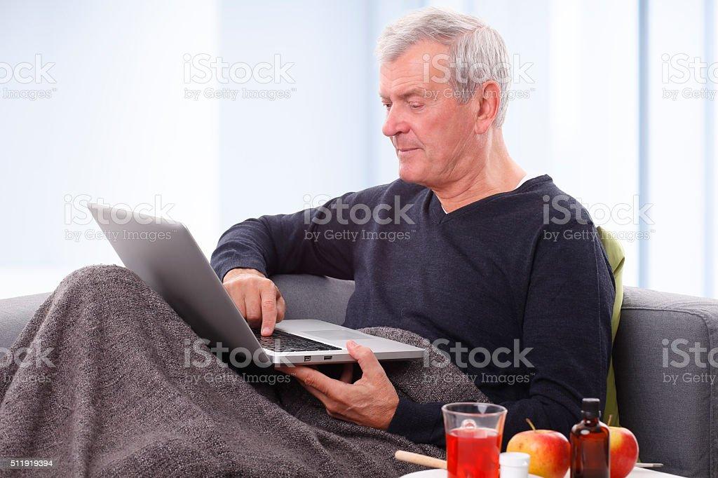 Senior with laptop stock photo