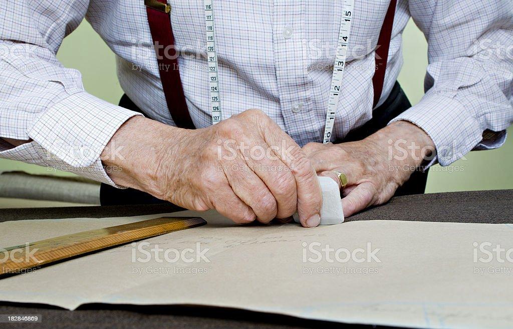 Senior with measuring band around neck working. royalty-free stock photo