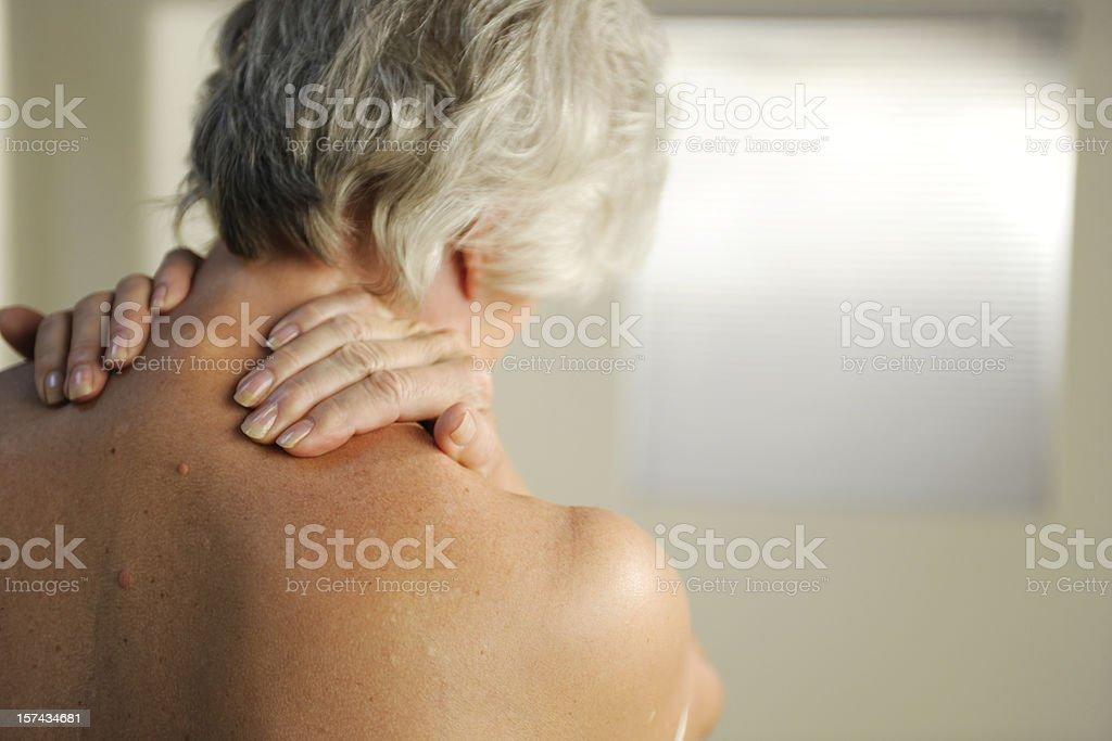 senior with neck pain