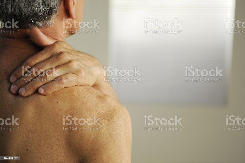 senior with neck pain royalty-free stock photo