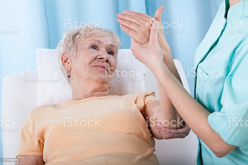 Senior with painful arm stock photo
