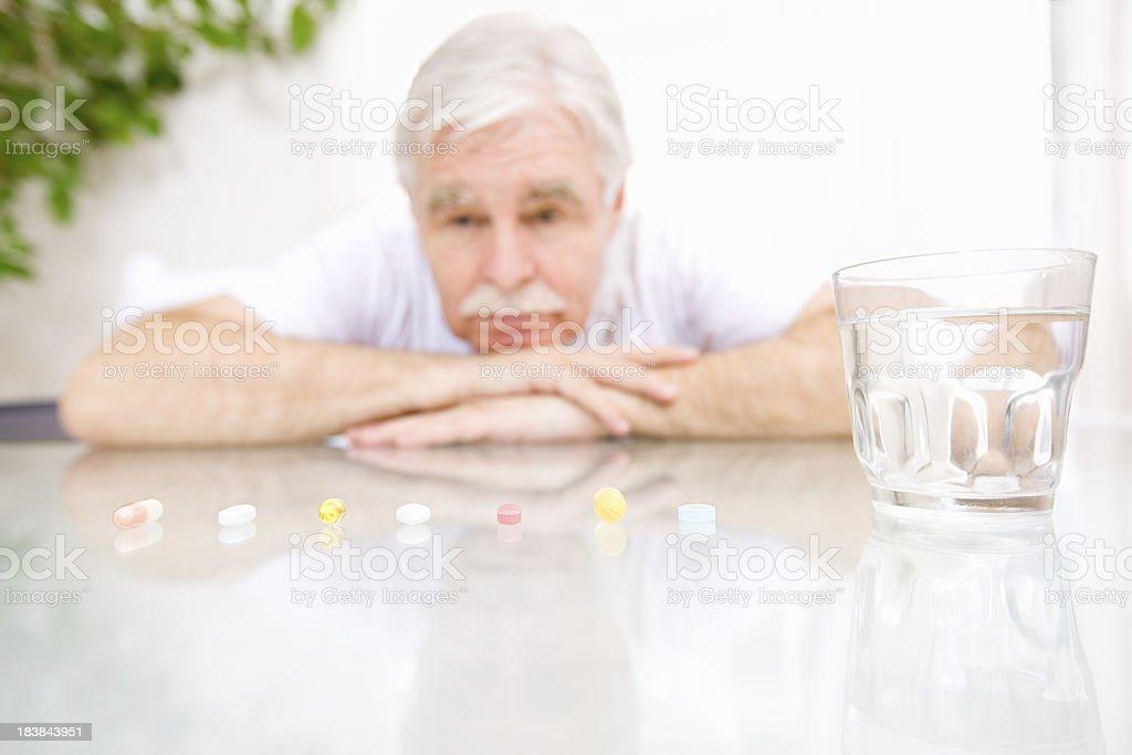 Senior with Pills royalty-free stock photo