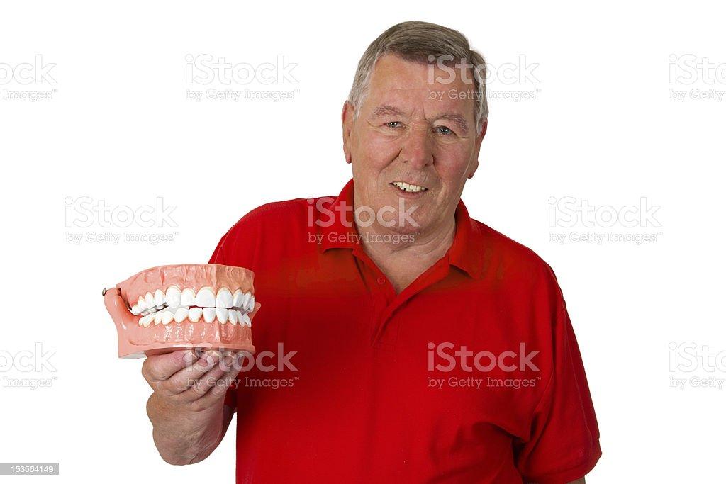 Senior with teeth model stock photo
