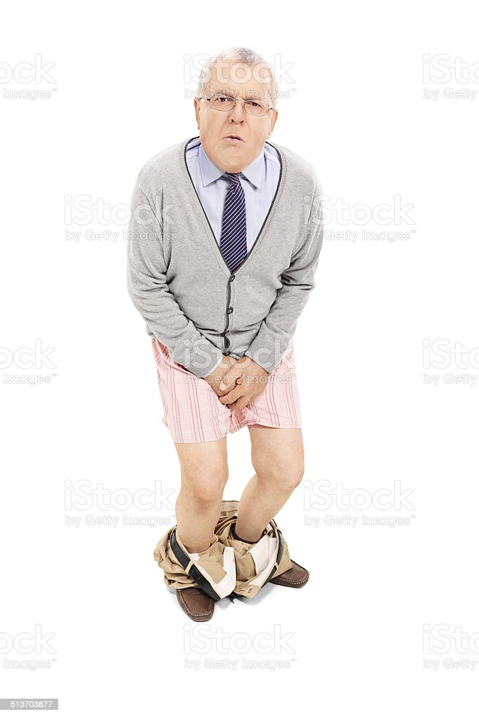 Senior with the pants down holding his crotch stock photo