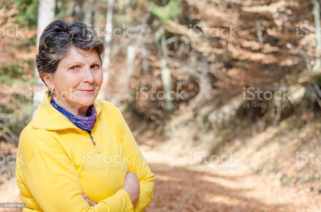 Senior Woman Along a Mountain Trail in Romania stock photo