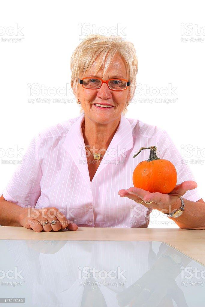 Senior Woman and a Pumpkin royalty-free stock photo