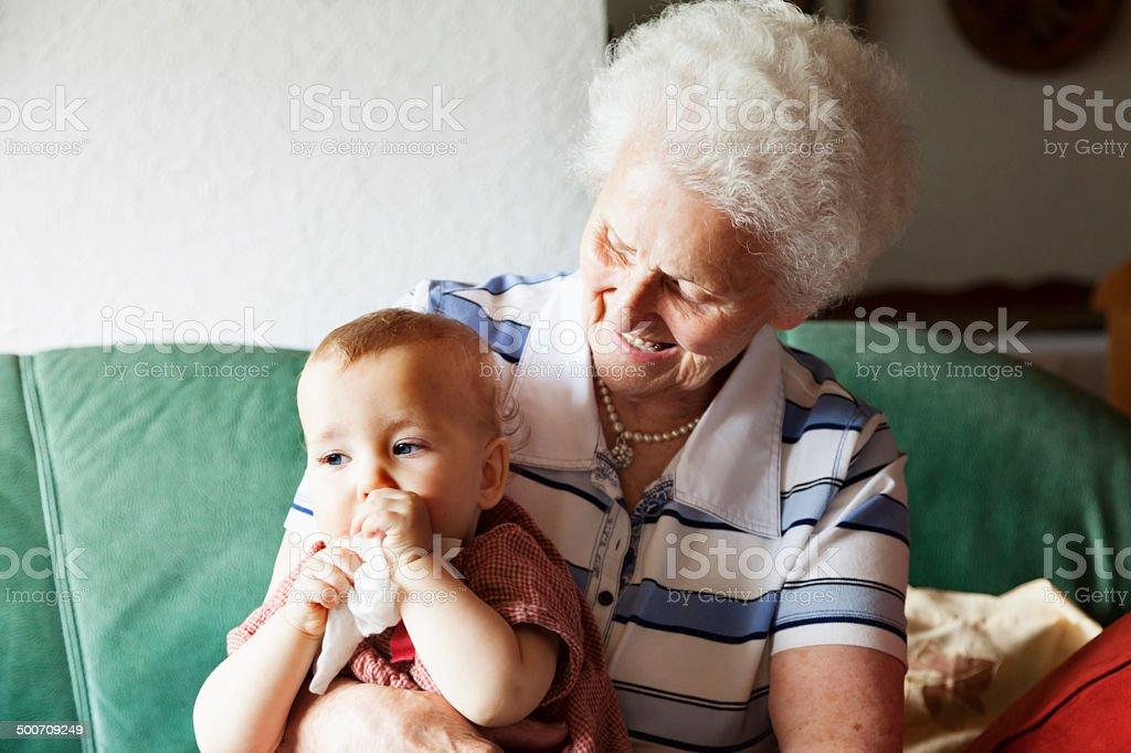 senior woman and baby girl stock photo
