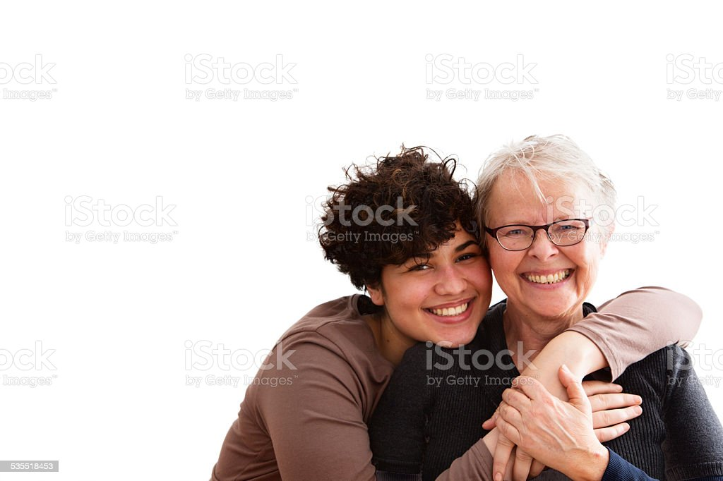 senior woman and caregiver embrace stock photo