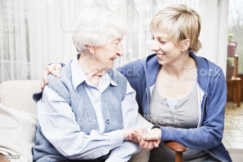 senior woman and caregiver togetherness royalty-free stock photo