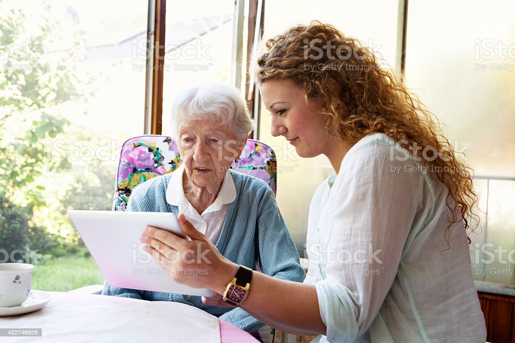 senior woman and digital tablet stock photo