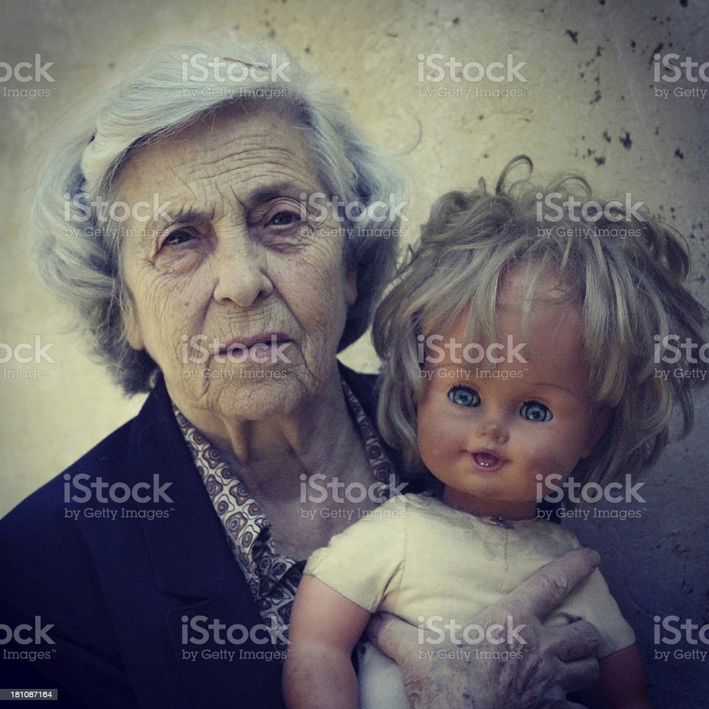 Senior woman and doll stock photo