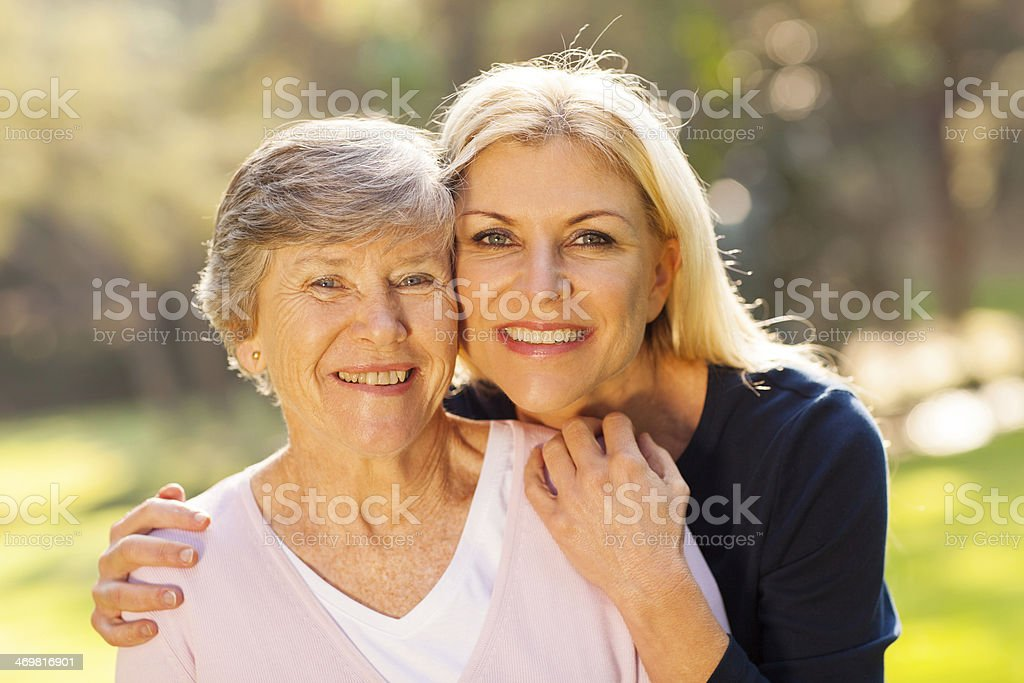 senior woman and middle aged daughter stock photo
