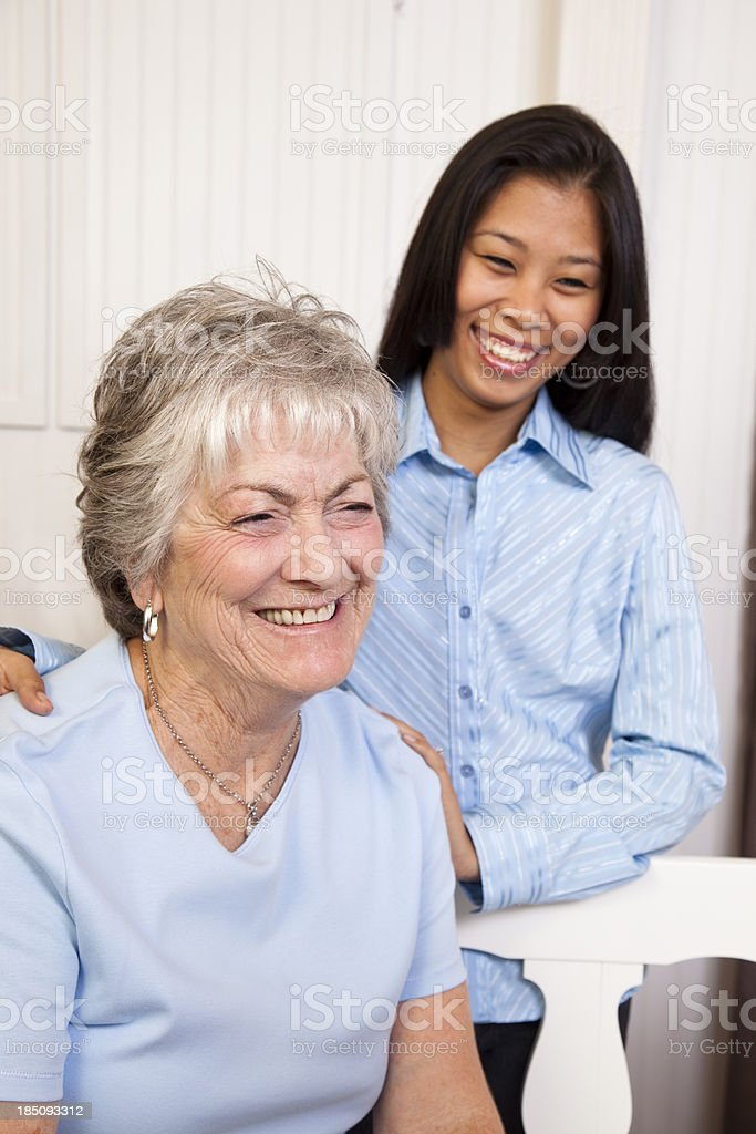 Senior woman and relative or friend laughing royalty-free stock photo