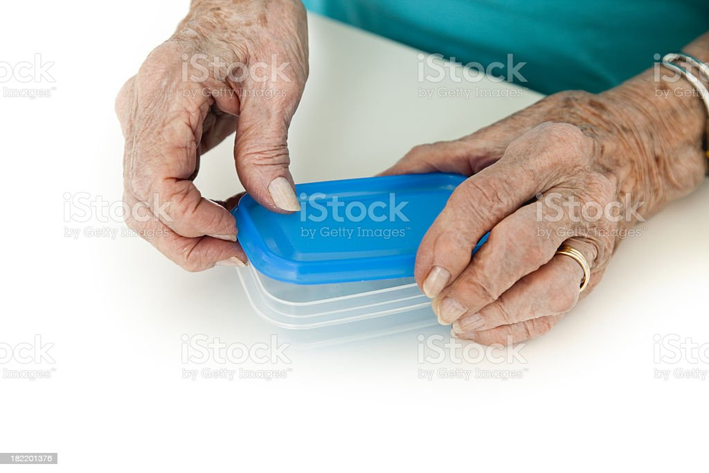 senior woman arthritis hands opening food container royalty-free stock photo