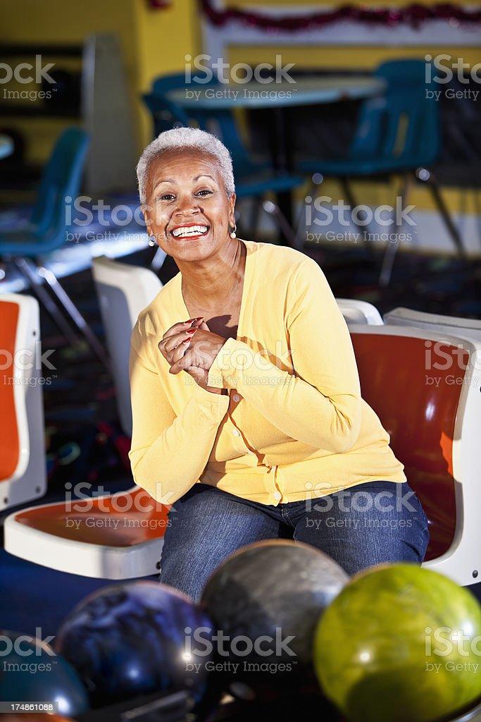 Senior woman at bowling alley stock photo