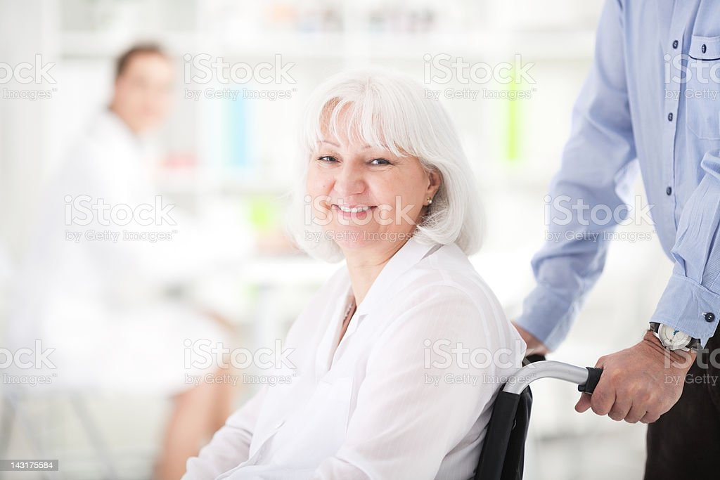 Senior woman at doctor's office royalty-free stock photo
