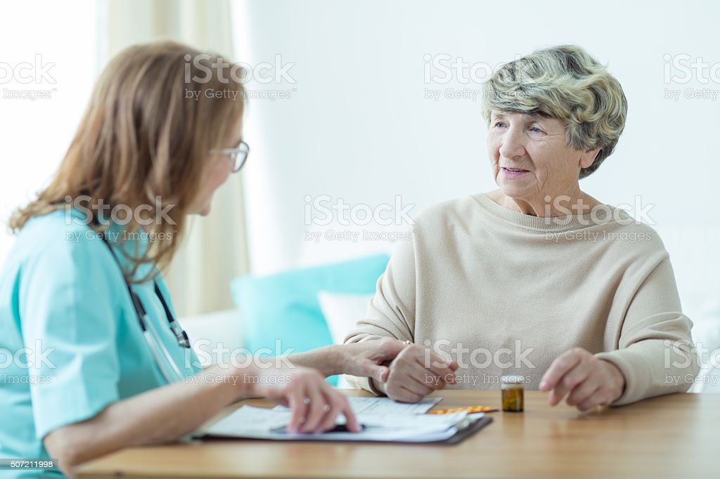 Senior woman at doctor's office stock photo