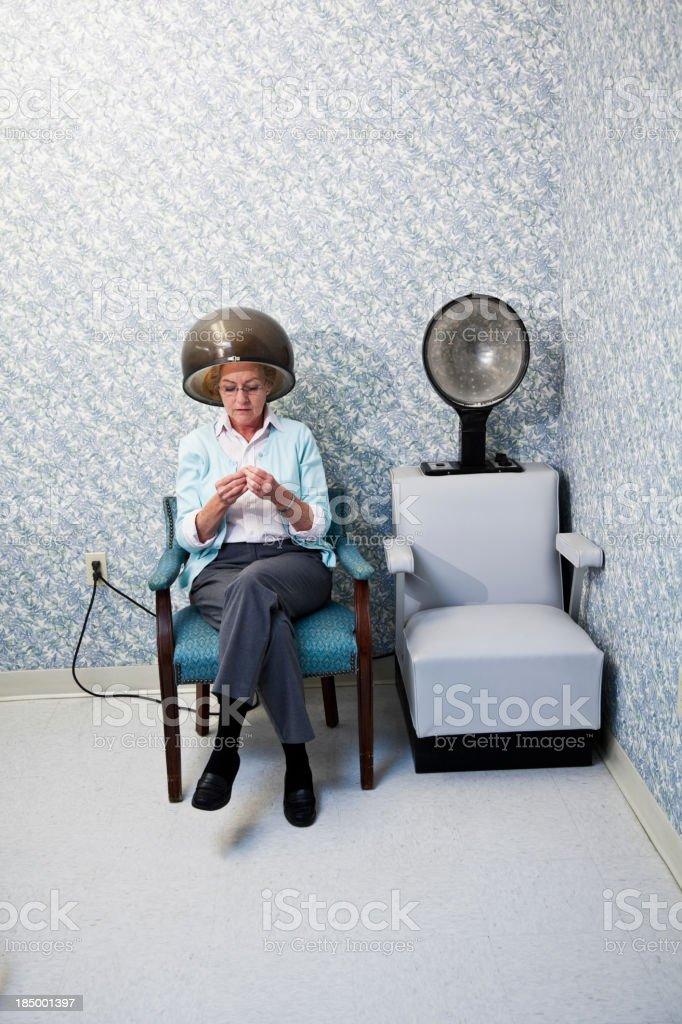 Senior woman at hair salon under dryer royalty-free stock photo