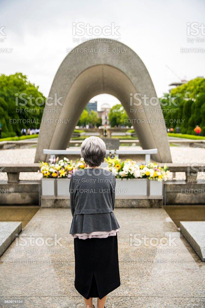 Senior woman at Hiroshima Peace Memorial Park stock photo