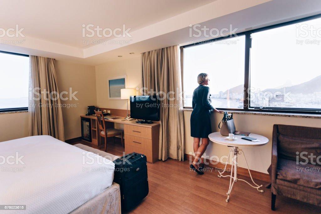 Senior Brazilian woman enjoying the view of Rio de Janeiro´s hotel...