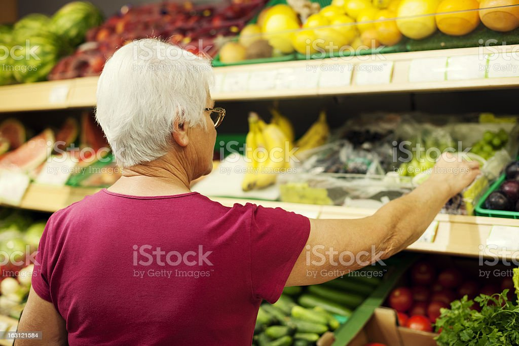 Senior woman at supermarket royalty-free stock photo