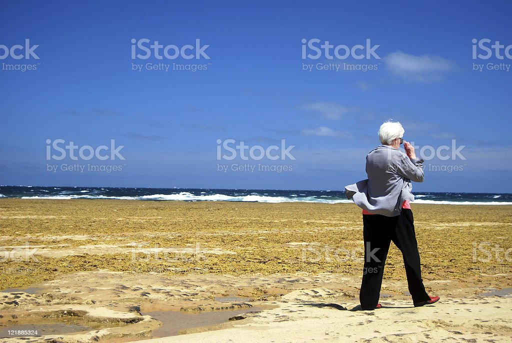 Senior woman at the beach stock photo