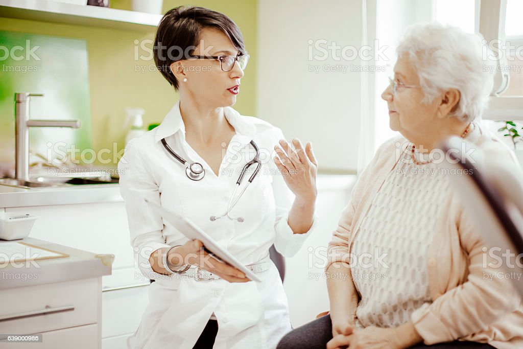 Senior woman at the doctor stock photo