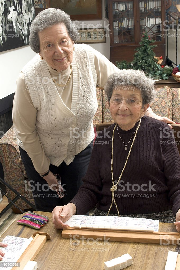 senior woman at the game table royalty-free stock photo