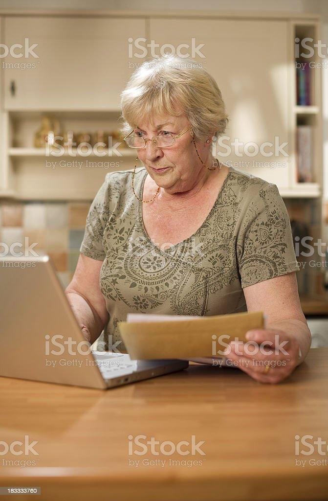 Senior Woman Banking Online royalty-free stock photo