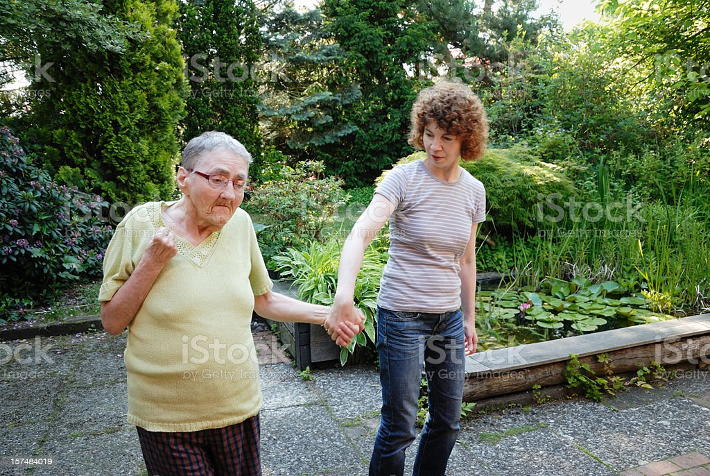 senior woman being assisted royalty-free stock photo