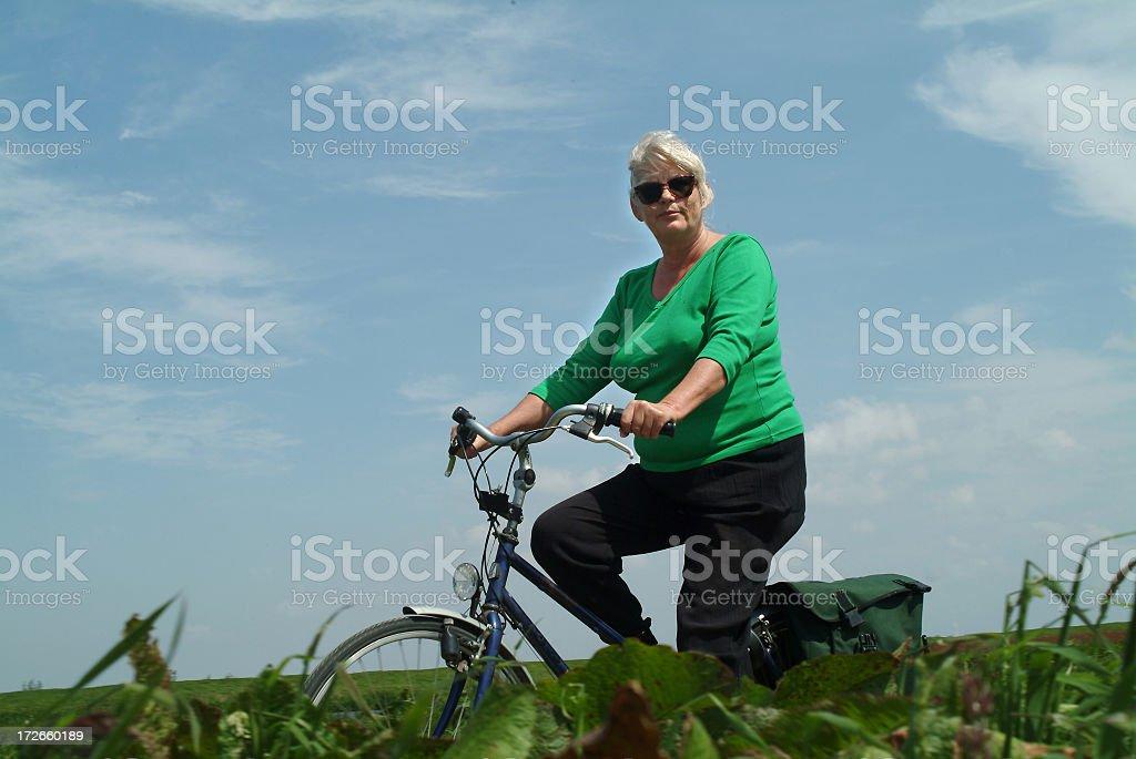 Senior Woman biking cycling royalty-free stock photo