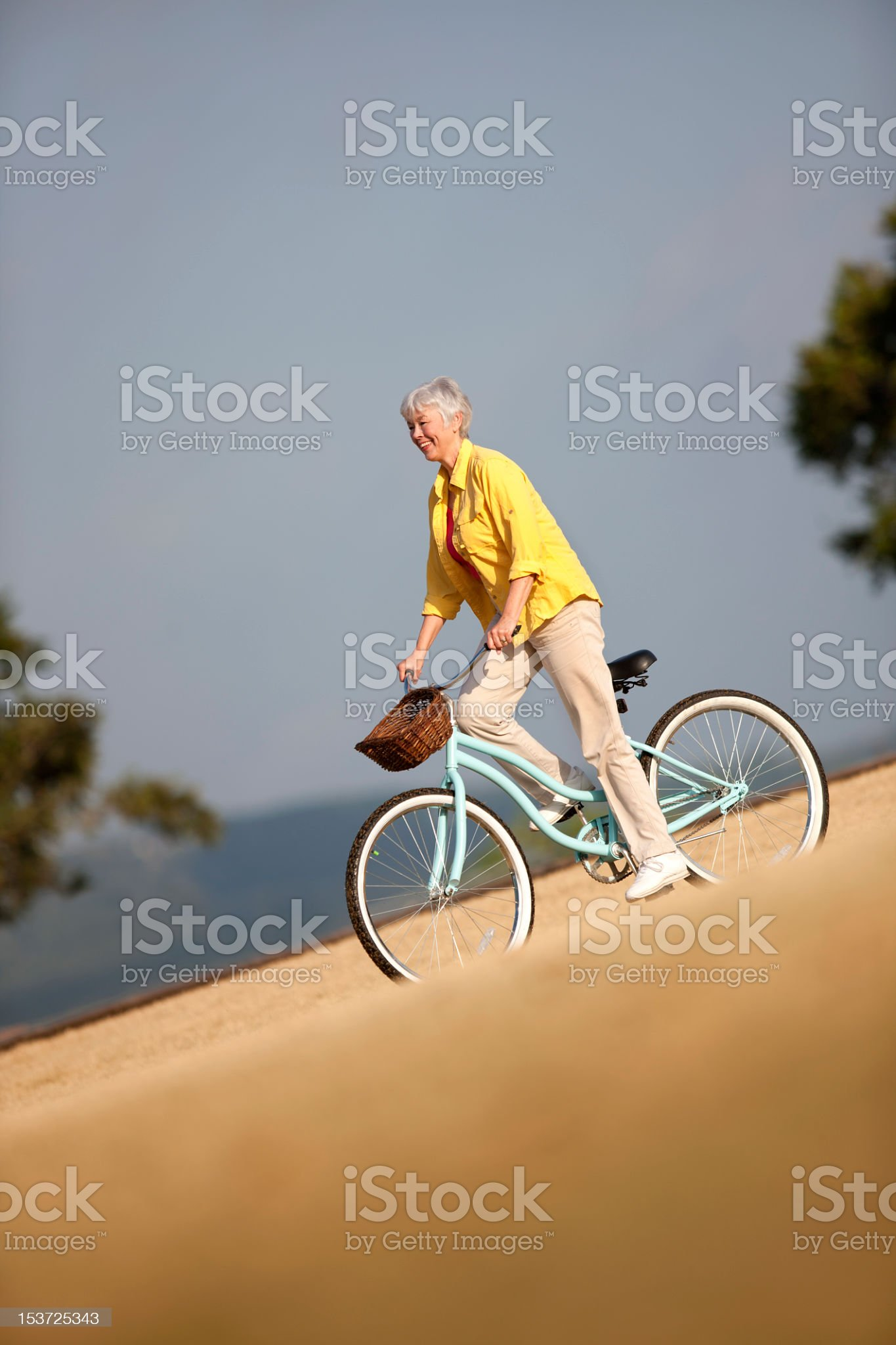 Senior Woman Biking royalty-free stock photo