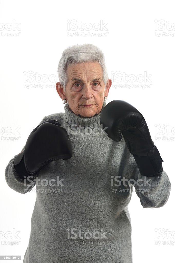 senior woman boxing stock photo