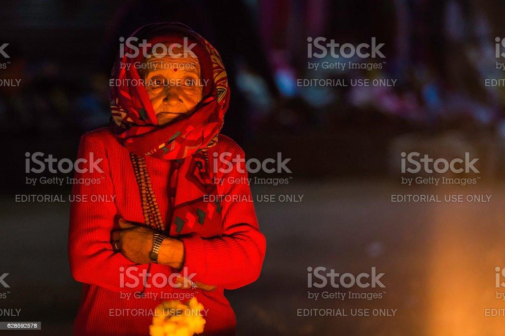 Senior woman Buddhist butter lamp seller Boudhanath temple Kathmandu Nepal stock photo