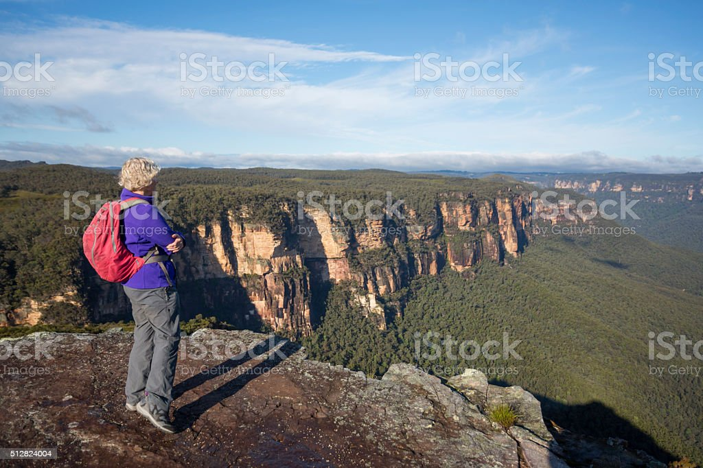 Senior Woman Bushwalker Enjoying Spectacular Landscape Views stock photo