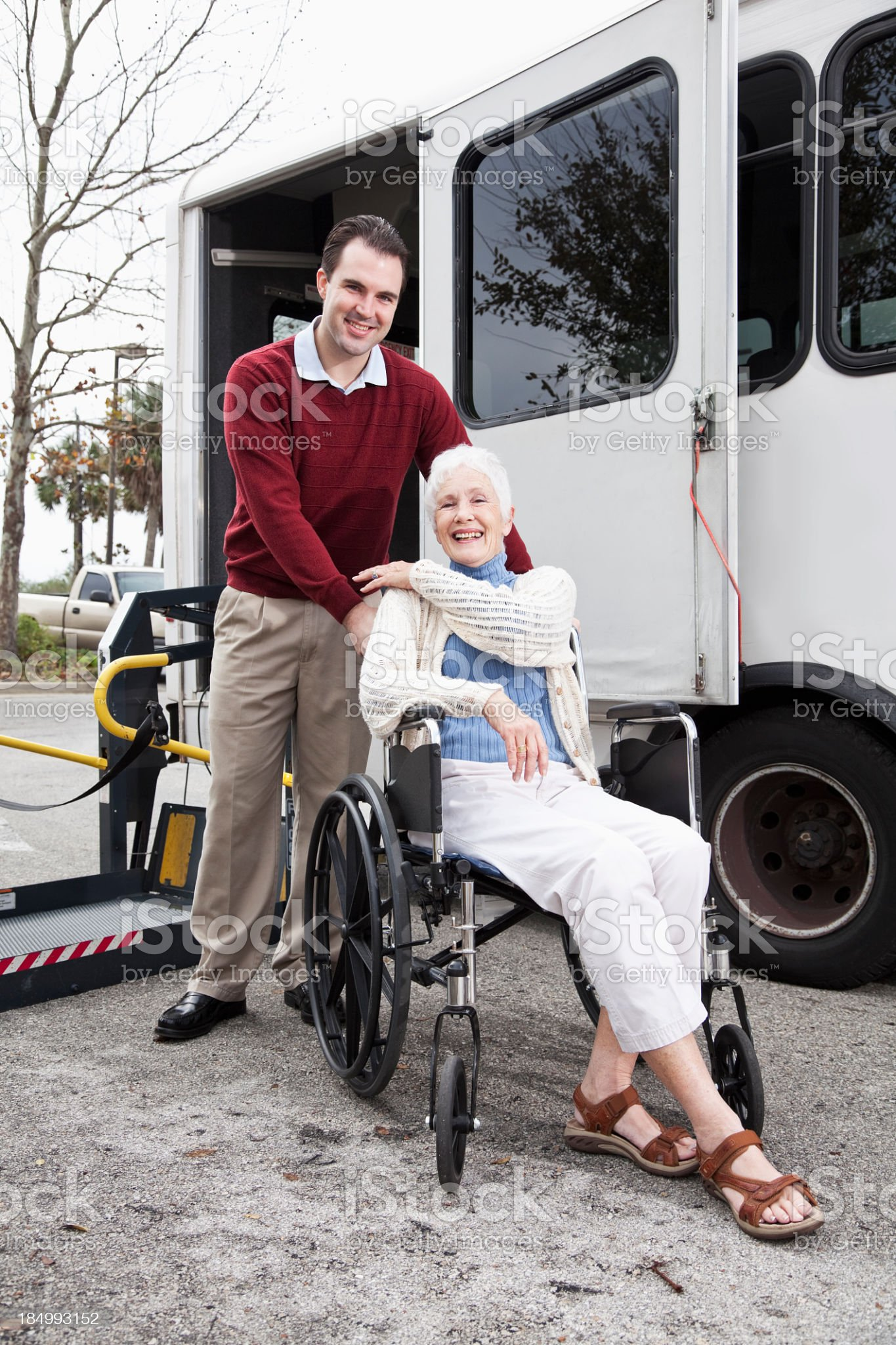Senior woman by minibus with wheelchair lift royalty-free stock photo