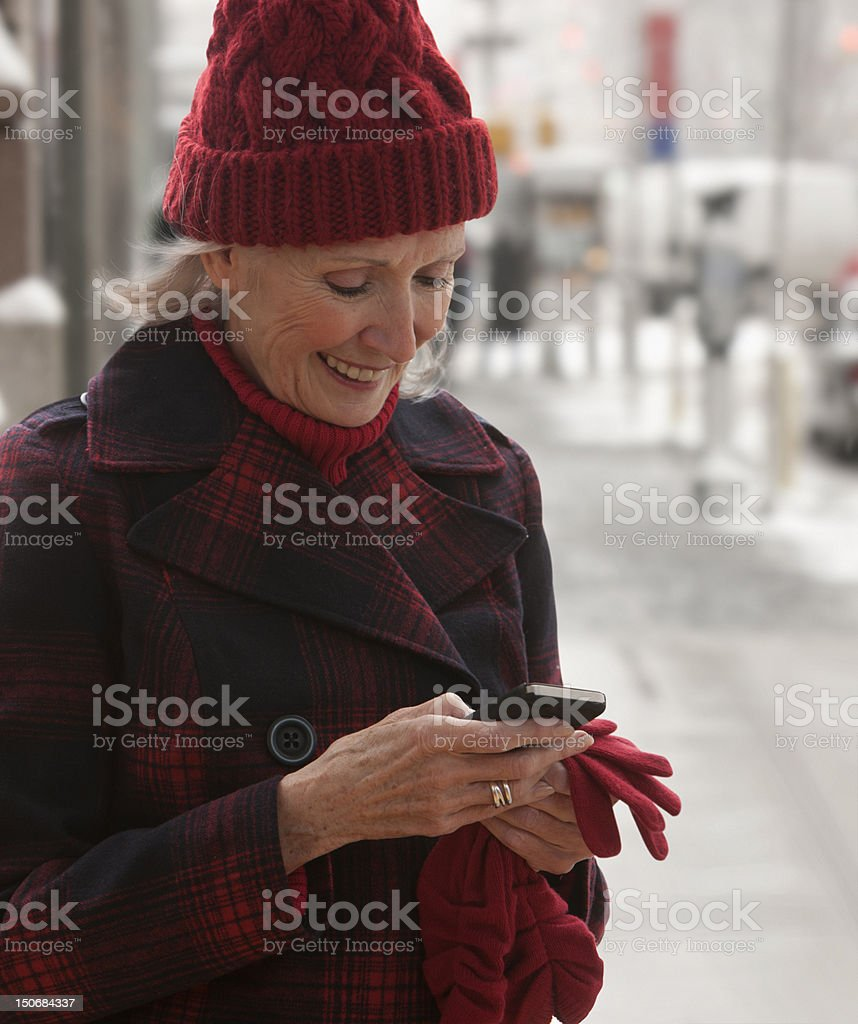 Senior woman checking mobile phone royalty-free stock photo