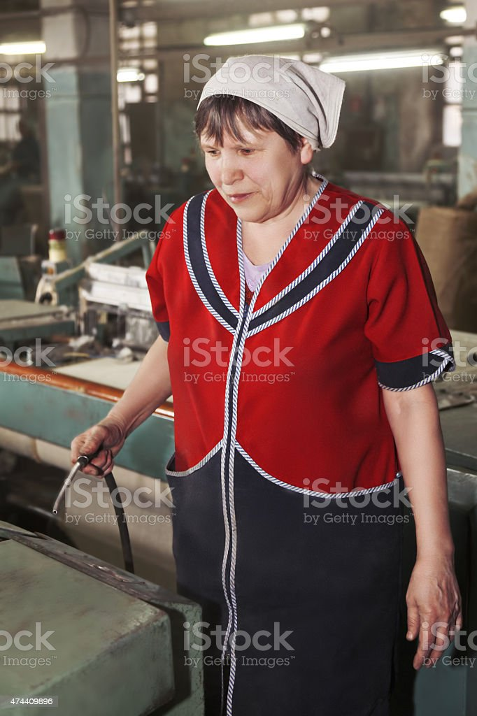 Senior woman cleaning machine stock photo