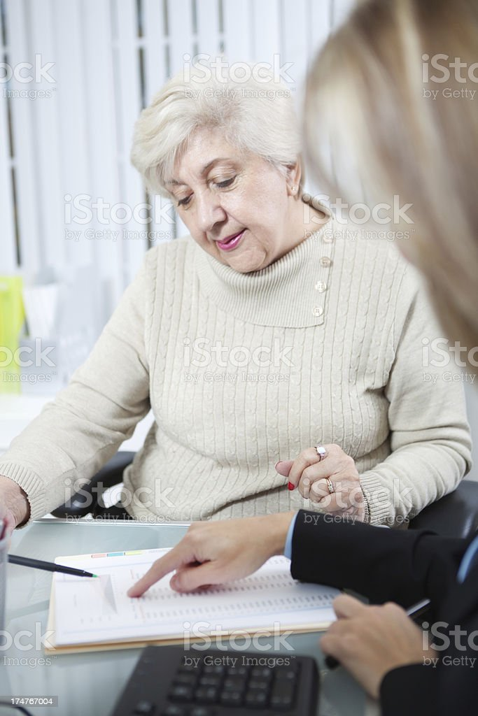 Senior Woman Client with Financial Professional Business Service Vt royalty-free stock photo