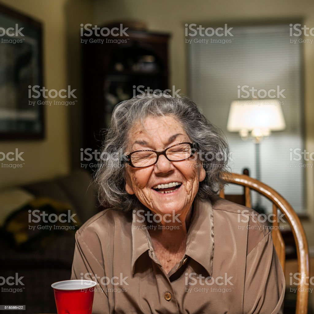 Senior Woman Closing Her Eyes Making Funny Face stock photo