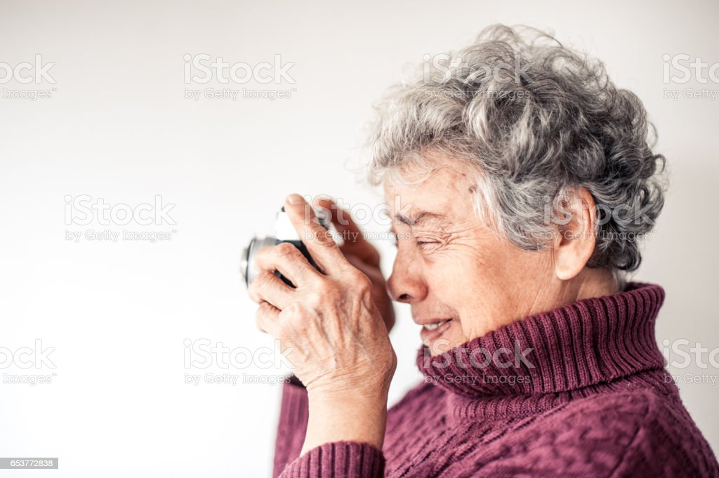 Senior Woman Collect Memories By Taking Photo stock photo
