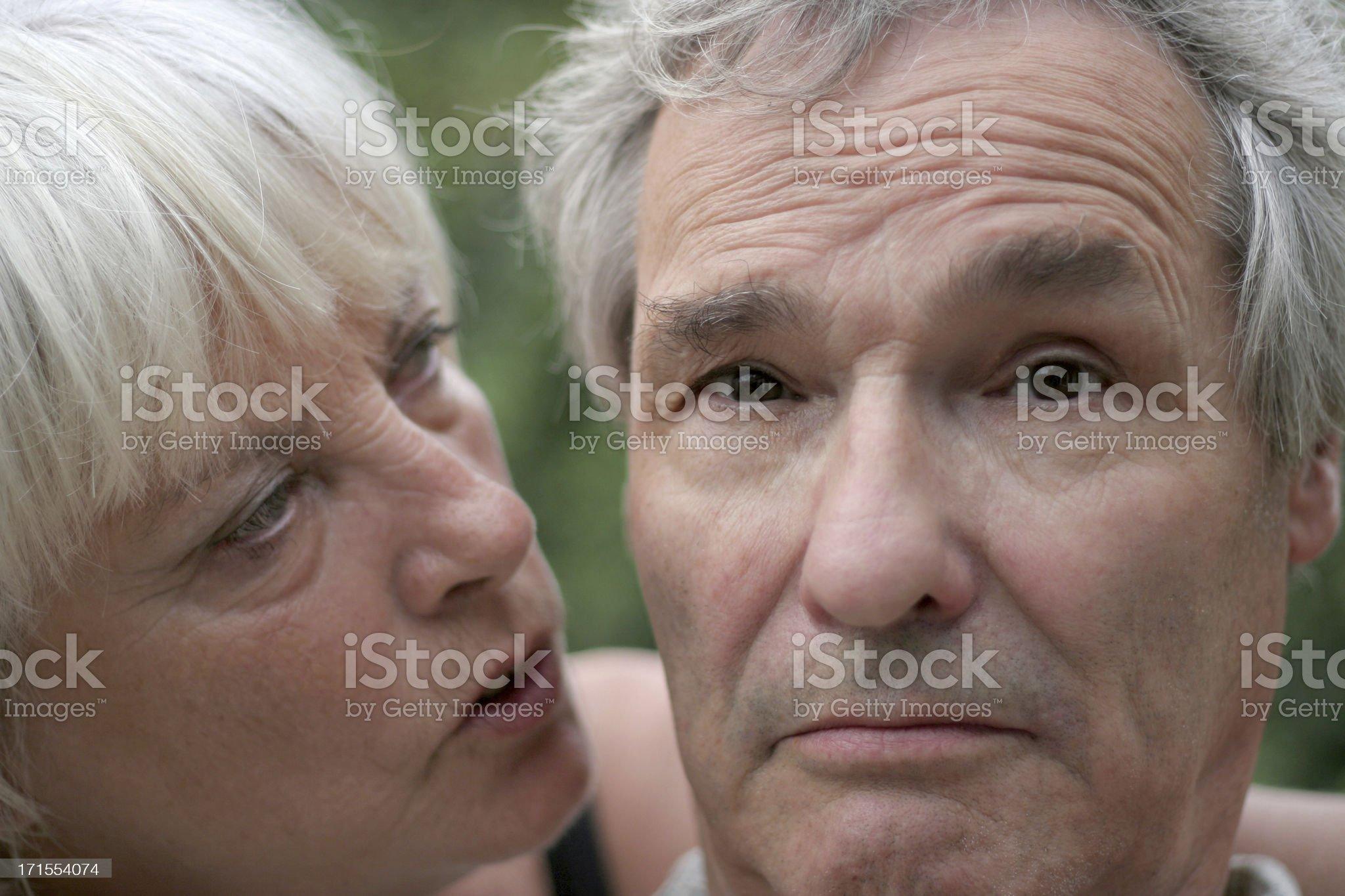 Senior woman comforts her Husband royalty-free stock photo