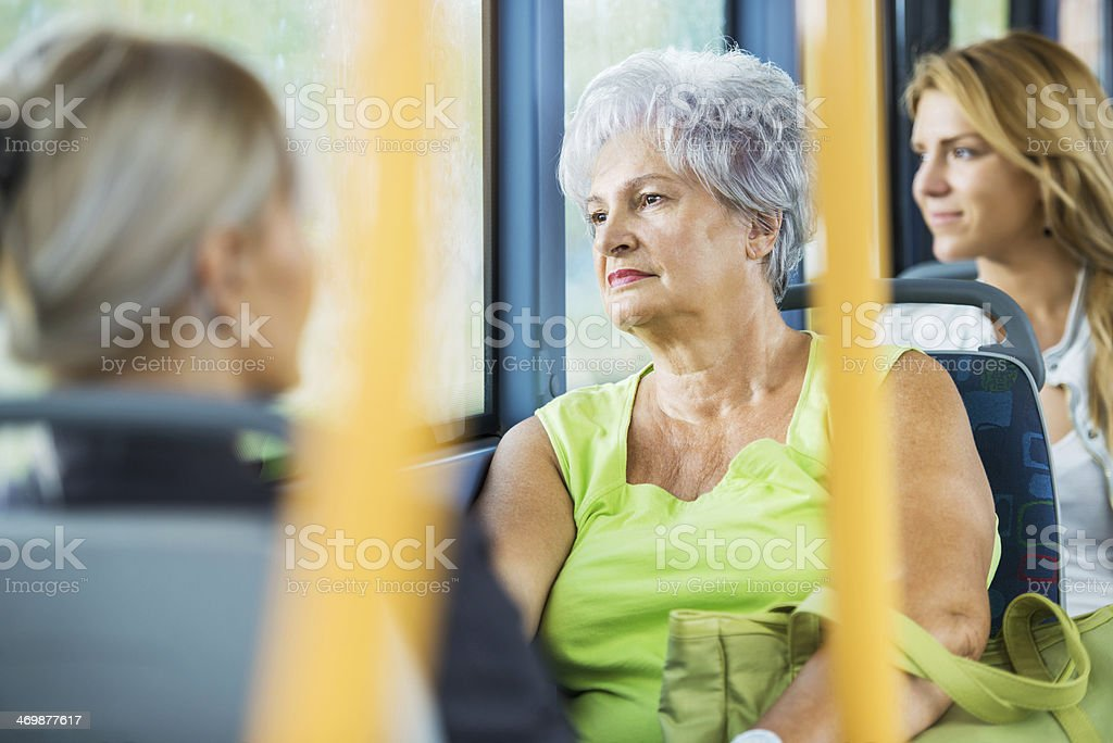 Senior woman commuting by bus. stock photo