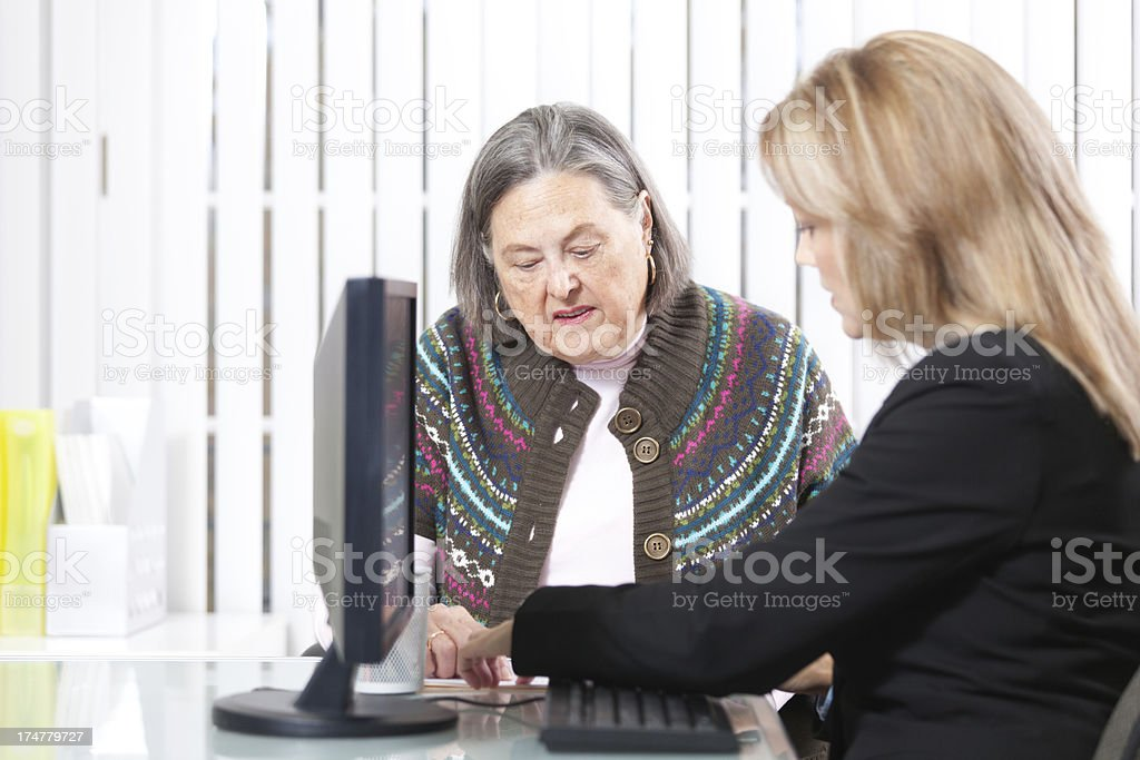 Senior Woman Consulting with Banking and Financial Advisor Hz royalty-free stock photo