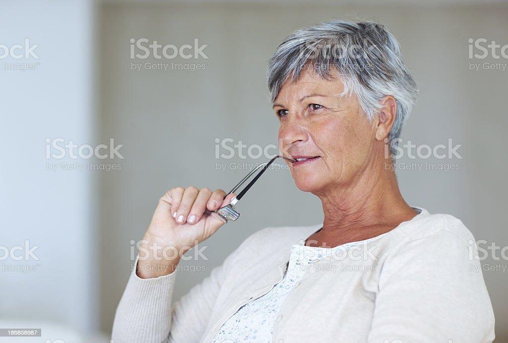 Senior woman contemplating royalty-free stock photo